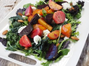 green salad with roasted beets and goat cheese crumbles
