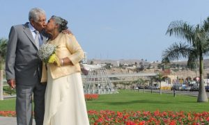 elderly couple in nice clothes kissing