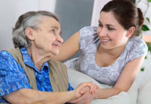 Adult daugther talking with aging mother